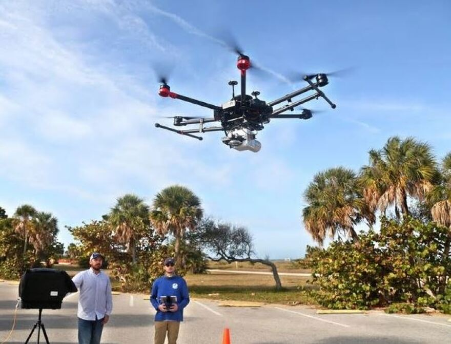 Andrew Lassiter and Connor Bass launch a drone