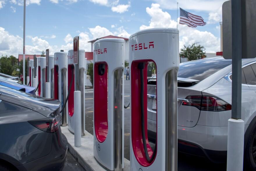 Tesla Supercharger station pumps lined up
