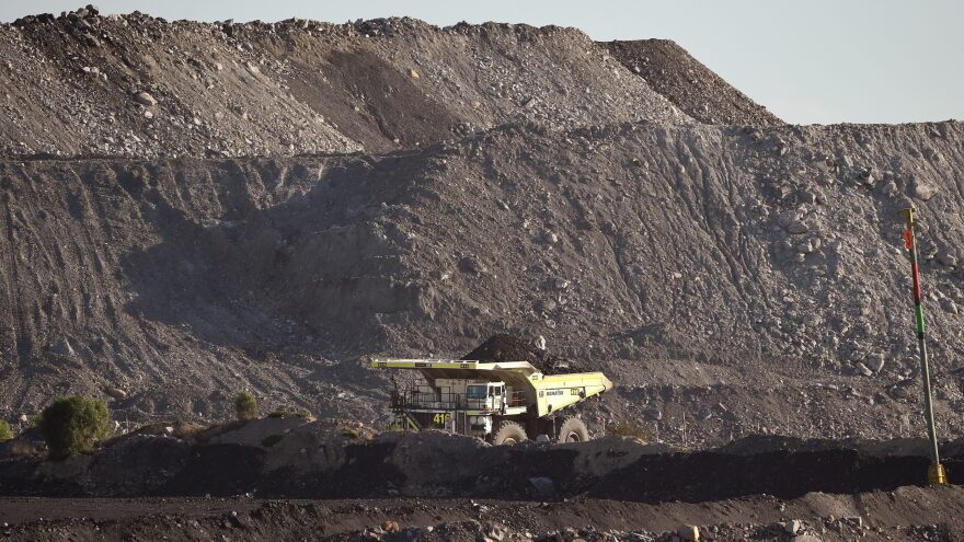 A large truck driving trough an open-cut coal mine in Singleton in the Hunter Valley north of Sydney as Australia, in 2015.