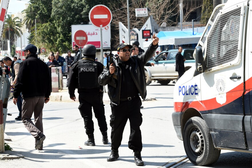 Tunisian security forces secure the area after gunmen attacked Tunis' famed National Bardo Museum on Wednesday.