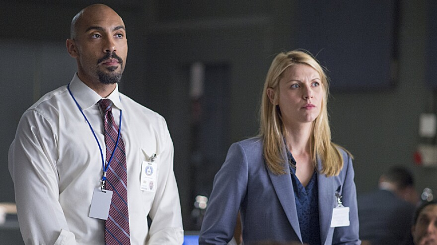 Claire Danes, right, plays CIA station chief Carrie Mathison with Alex Lanipekun on Showtime's <em>Homeland</em>.