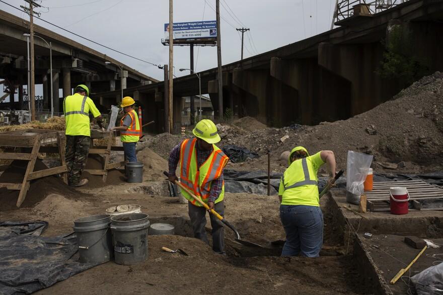 Archaeologists work near the Poplar Street Bridge in downtown St. Louis in April, 2017.