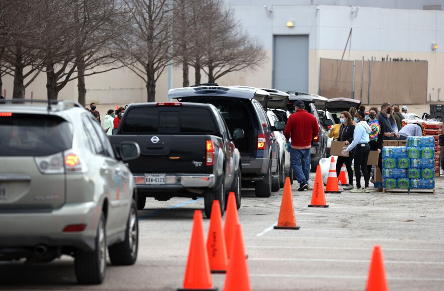 Thousands line up Sunday to receive food and water at a mass distribution site at NRG Stadium for Houston residents who are still without running water and electricity following last week's winter storm.