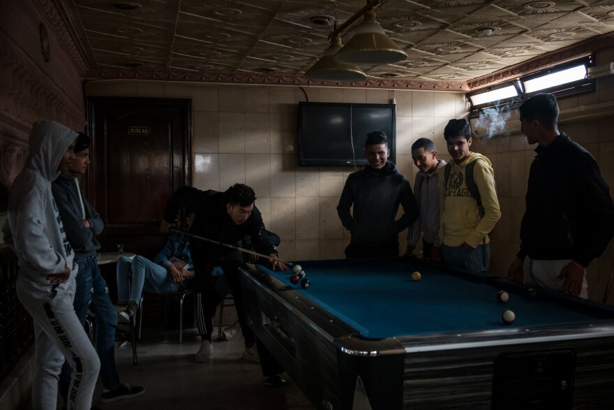 High school students play pool during a break between classes in Sousse, Tunisia, in February.