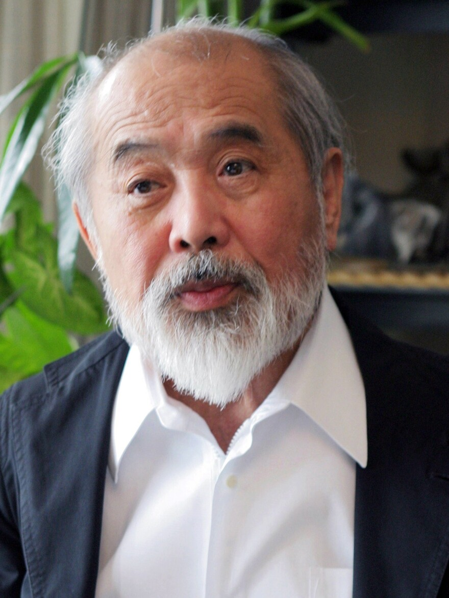 A 2004 photo shows Japanese industrial designer Kenji Ekuan. The creator of a classic soy sauce bottle and other products died at a hospital in Tokyo on Sunday. He was 85.