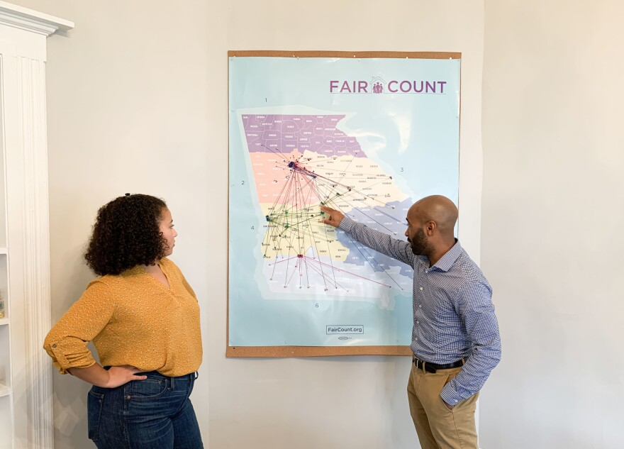 Ed Reed (right), Fair Count's program director, and Djemanesh Aneteneh, an operations and events administrator, look over a map showing the Wi-Fi hot spots the group has installed around Georgia.