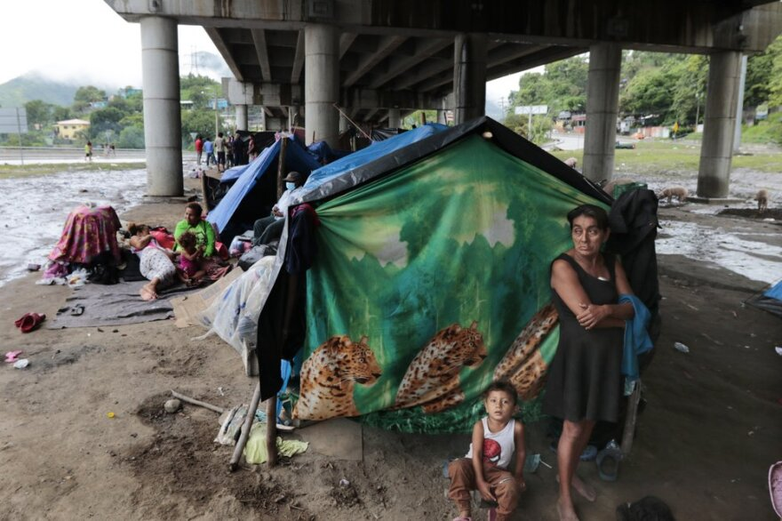 Hondurans left homeless by Hurricanes Eta and Iota this month living in tents on the only patch of dry ground they can find, under a highway in the northern city of San Pedro Sula.