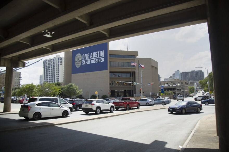 The Austin Police Department headquarters as seen from under the I-35 overpass at Eighth Street.