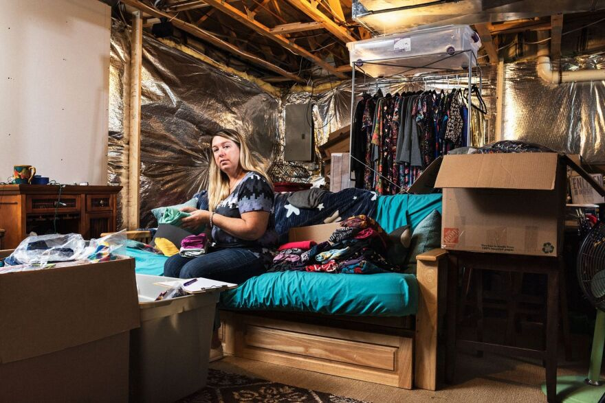 Amy Jo Reece in her basement in Culpepper, Va., with her unsold inventory. (Damon Casarez for Bloomberg Businessweek)