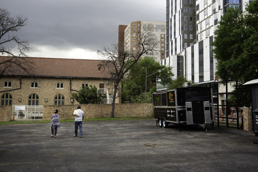Poornima Omkant and Omkant Noubad walk in the empty lot where their food cart, Little Vibes, was set to open March 20.