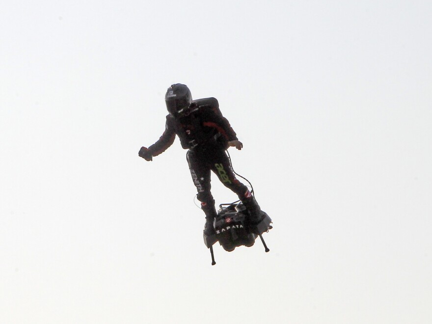Franky Zapata, a 40-year-old inventor, takes to the air in Sangatte, Northern France, at the start of his attempt to cross the channel from France to England on Thursday.