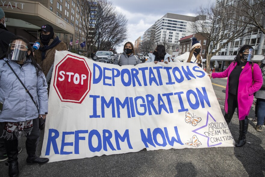 Pro-immigration reform activists hold a banner during the inauguration ceremony in Washington, D.C.