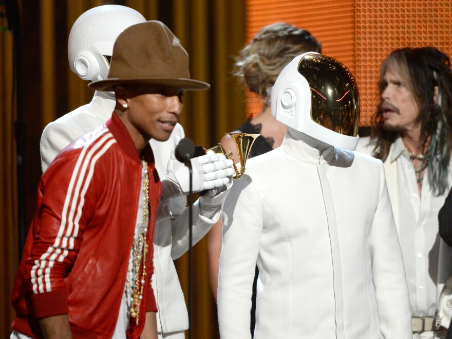 """Pharrell Williams, with Thomas Bangalter and Guy-Manuel De Homem-Christo of Daft Punk, accepts the Record of the Year award for """"Get Lucky."""""""