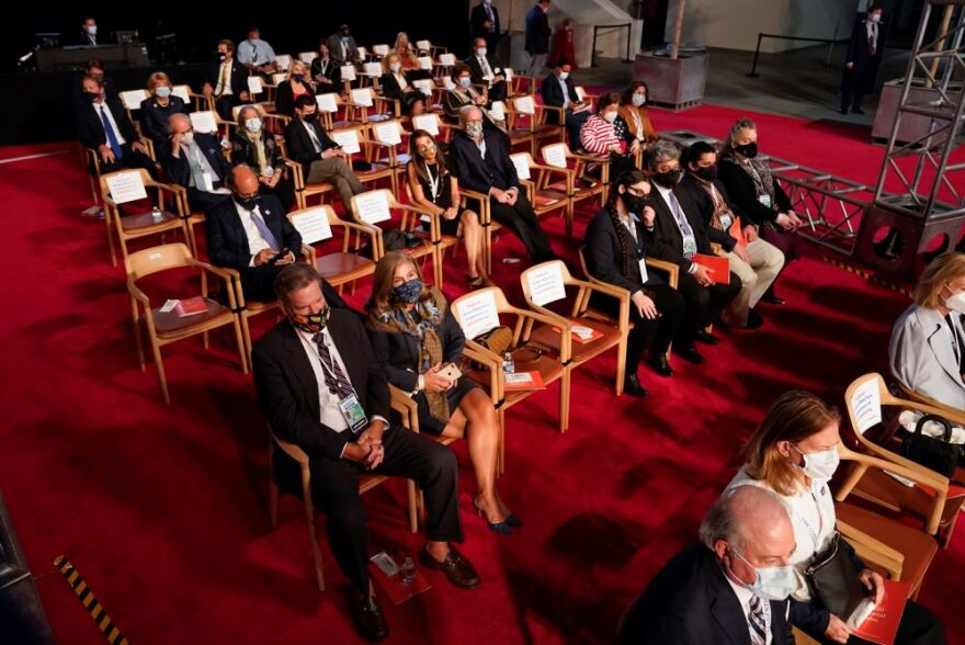 a photo of guests at the Cleveland debate.