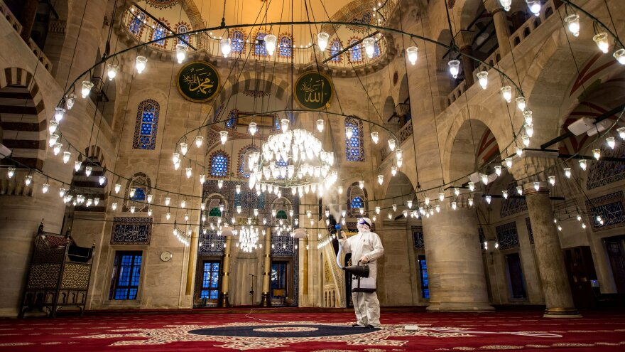 A government worker disinfects the Kılıç Ali Pasa mosque in Istanbul last week. Turkey is just one of a host of countries across the Muslim world where Friday prayers have been banned or curtailed to stem the spread of the coronavirus.