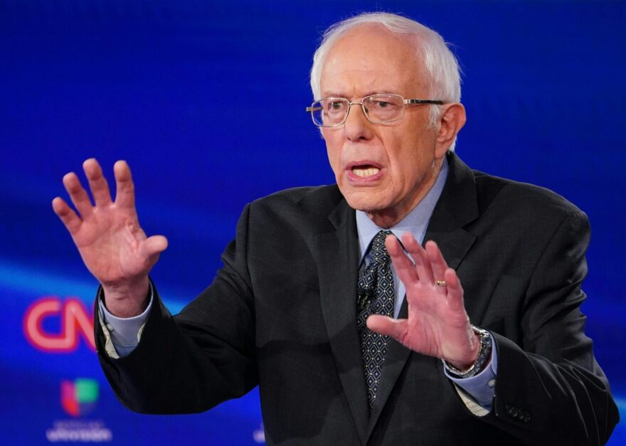 Senator Bernie Sanders makes a point as he and former Vice President Joe Biden take part in a presidential debate.