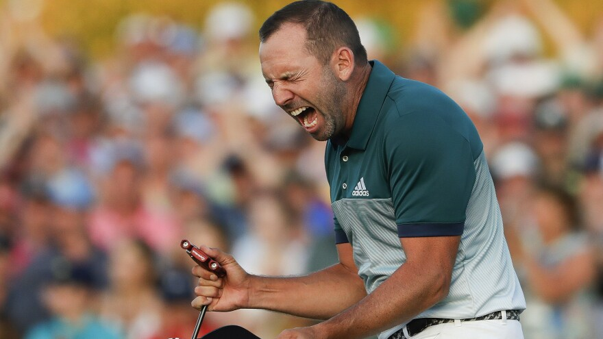 Sergio García of Spain reacts after making his birdie putt on the 18th green to win the Masters golf tournament after a playoff against Englishman Justin Rose on Sunday in Augusta, Ga.
