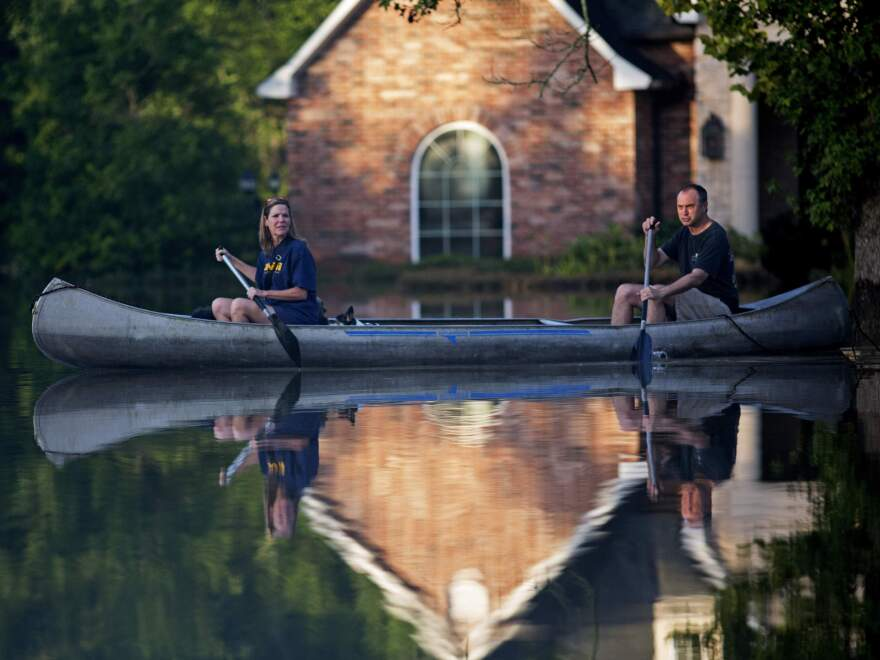 Danny and Alys Messenger canoe away from their flooded home in Prairieville, La., after reviewing the damage. As waters begin to recede in parts of Louisiana, some residents have struggled to return to flood-damaged homes on foot, in cars and by boat.