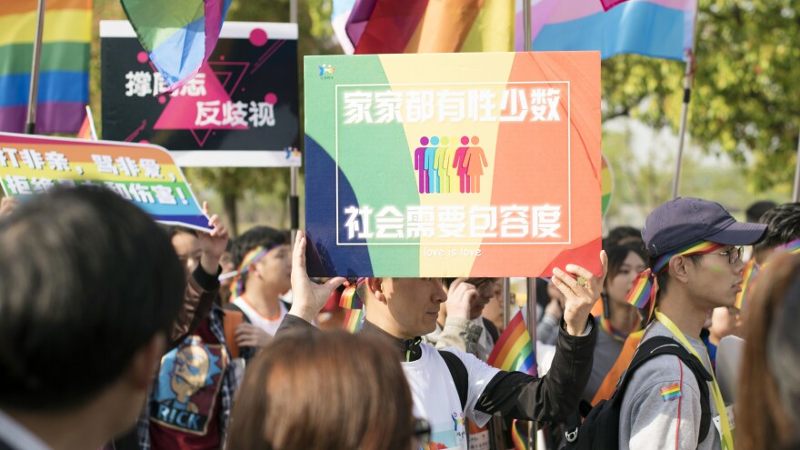 "Days after Weibo announced it would ban homosexual content, an already-planned rally was held in Nanjing, China, to raise awareness of discrimination against homosexuals. This photo from Sunday was released to the AP by the Jiangsu Tongtian Volunteer Group, which said more than 20,000 people took part in the ""Rainbow Marathon"" event."