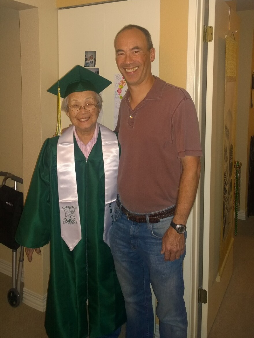 Mary Matsuda Gruenewald in her cap and gown with her son Ray Gruenewald.