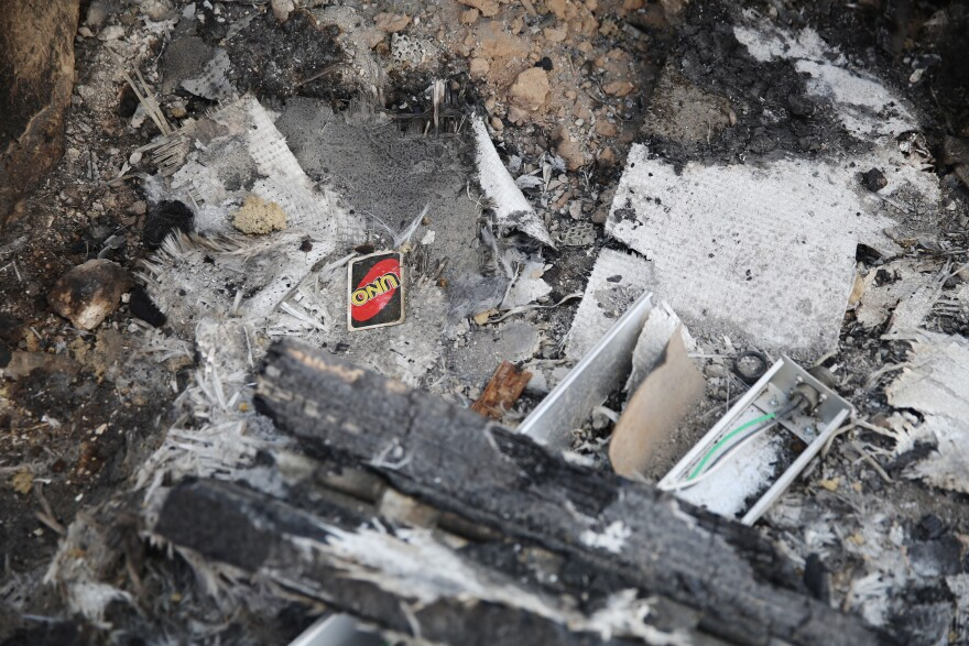An Uno playing card lies in the rubble of the Ain al-Assad air base. The base, used by the U.S. since 2003, houses about 1,500 U.S. troops and additional coalition troops supporting Iraqi anti-ISIS operations.