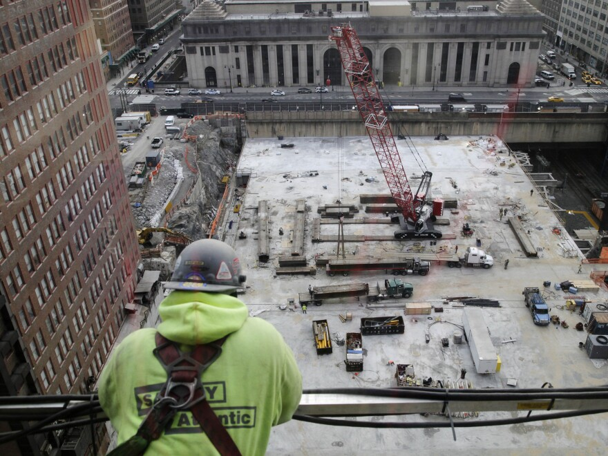 A construction worker looks down on the site of the Manhattan West project last month in New York. Construction was among the hardest-hit sectors during the worst recession in modern memory.