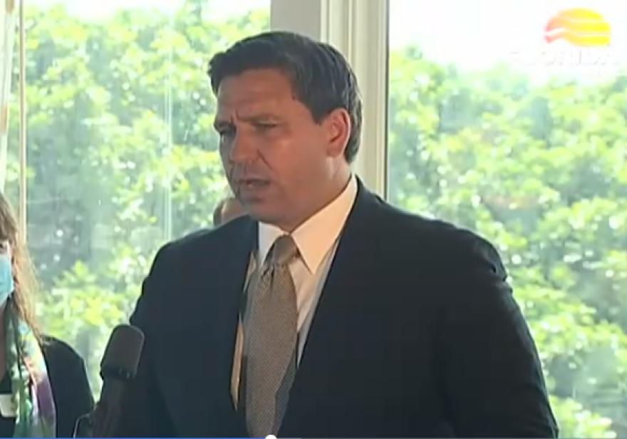 Florida Governor Ron DeSantis speaks at a podium