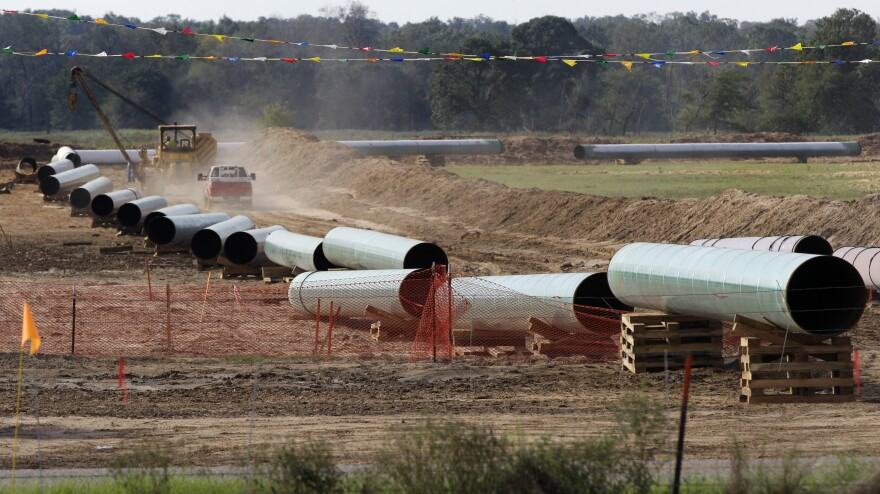 A 2012 photo shows sections of pipe on a neighboring property to Julia Trigg Crawford family farm in Sumner Texas, in the path of the Keystone pipeline. TransCanada said today that it is delivering oil through the Gulf Coast portion of its proposed Keystone XL pipeline, from a hub in Cushing, Okla., to Houston-area refineries.
