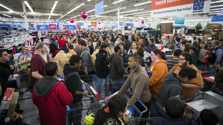 Customers flood Walmart's Bentonville, Ark., store on Thanksgiving Day in 2016.