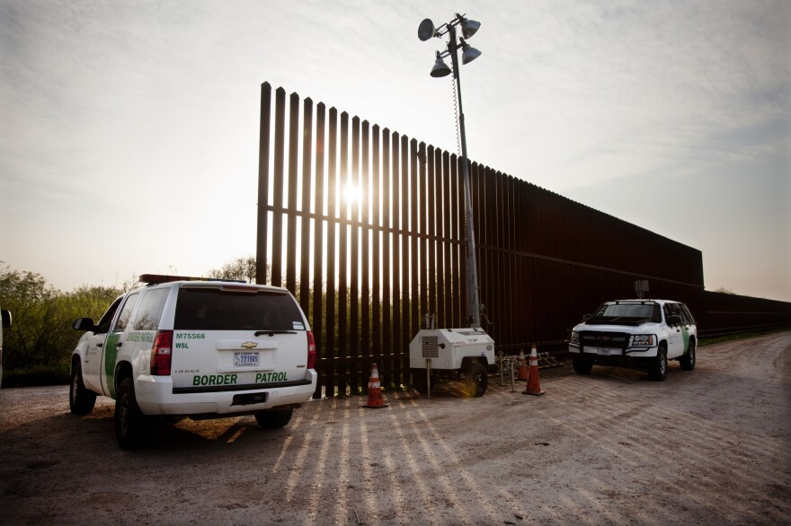 United States border patrol agents monitor a fence in Hidalgo, Texas in 2014.