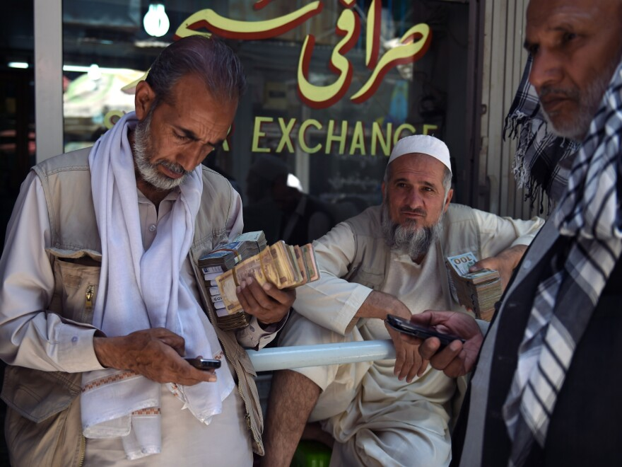 Afghanistan's currency has fallen by 12 percent against the U.S. dollar in the past year. Some Afghan money changers now prefer to covert their earnings to dollars.