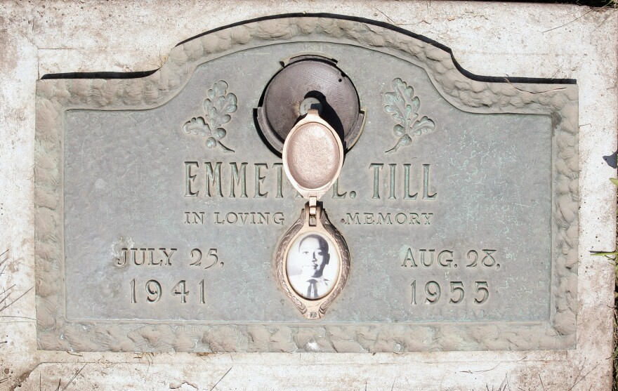 A plaque marks the gravesite of Emmett Till at Burr Oak Cemetery in Alsip, Ill. The 14-year-old was killed in Mississippi in 1955. The FBI has reopened the investigation into his lynching.