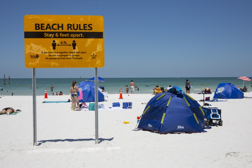 Signs will remain in place at Pinellas County beaches, encouraging visitors to follow the best practices to prevent the spread of coronavirus.