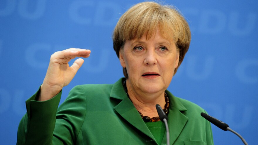 German Chancellor Angela Merkel, shown here at a press conference in Berlin on Monday, has led the call for austerity in Europe. But Sunday's elections in France and Greece point to a growing backlash on the Continent.