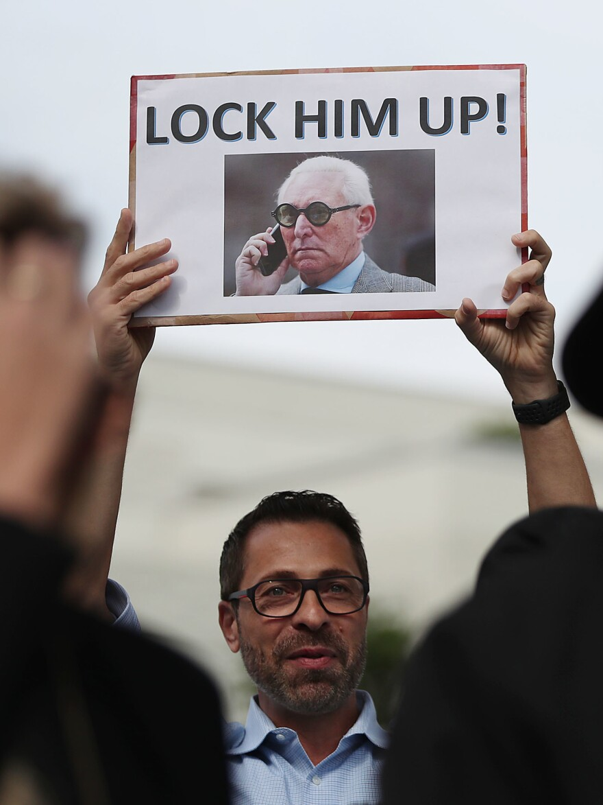 Protest signs were waiting for Roger Stone outside the federal courthouse Friday in Fort Lauderdale, Fla.