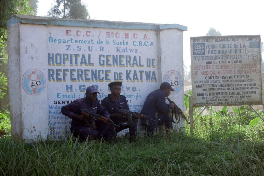 Police guard a hospital in Butembo, Congo, on Saturday after militia members attacked an Ebola response command center in the city's Katwa district overnight.