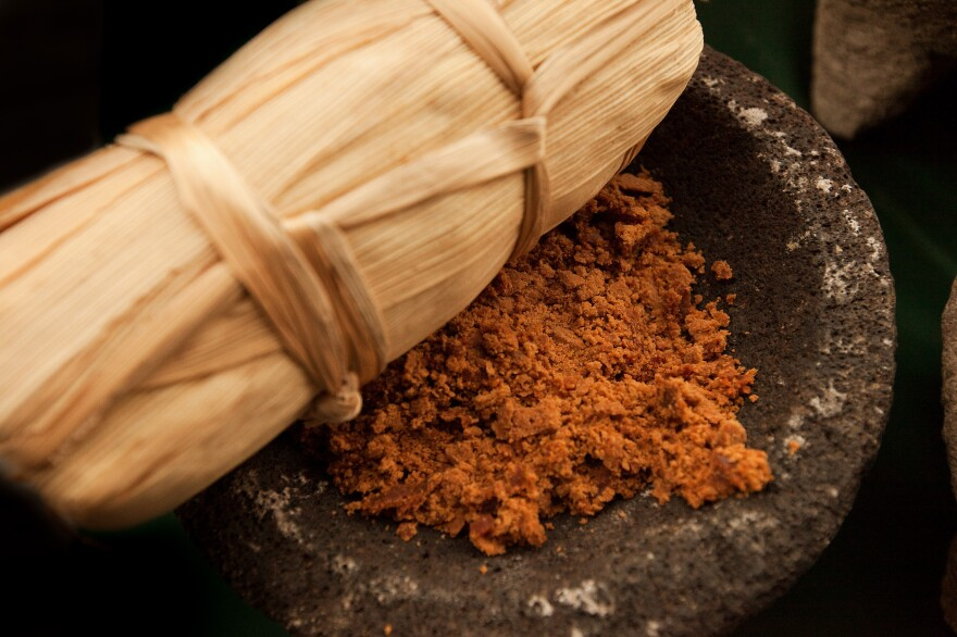 Food: The ancestor's favorite meals are placed on the altar as offerings. Here, Tamale is being served. Tamales are made from corn-based dough, wrapped in cornhusk then steamed. They are filled with a variety of ingredients like shredded chicken in a green spicy sauce or sweetened with pineapple-cinnamon jellies
