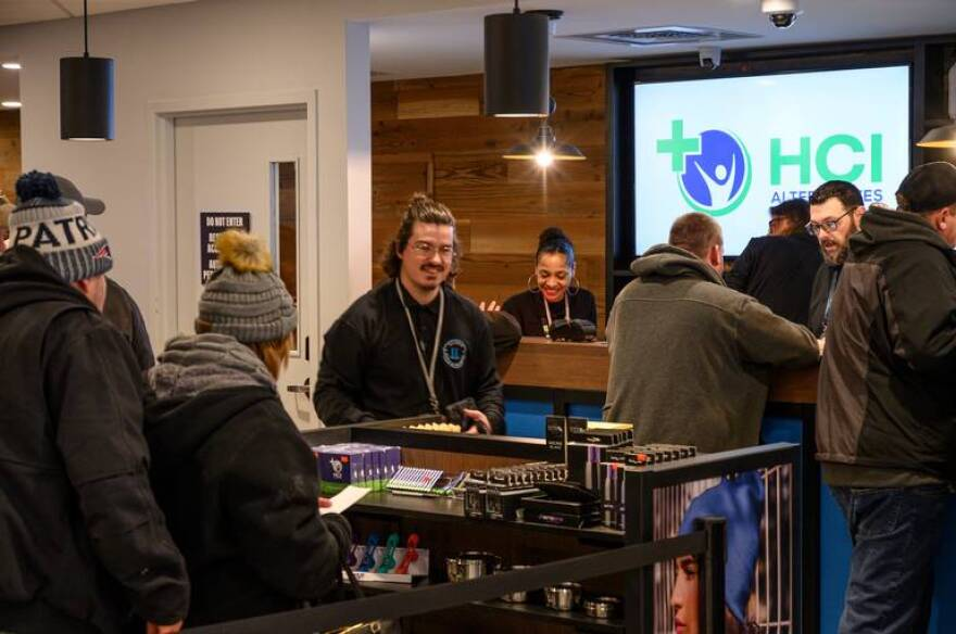 Shoppers browse products inside a Collinsville recreational marijuana dispensary owned by Ascend Wellness Holdings. The store is at 1014 Eastport Plaza Dr.
