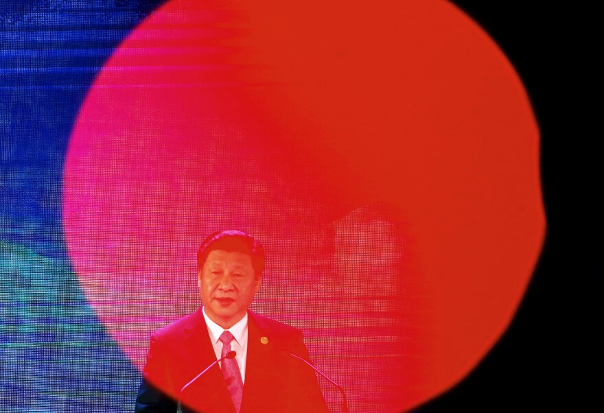 China's President Xi Jinping speaks at the Asia-Pacific Economic Cooperation Summit in Manila, Philippines, on Wednesday. Xi condemned the killing of a Chinese citizen by ISIS, but did not specify any actions that China might take.