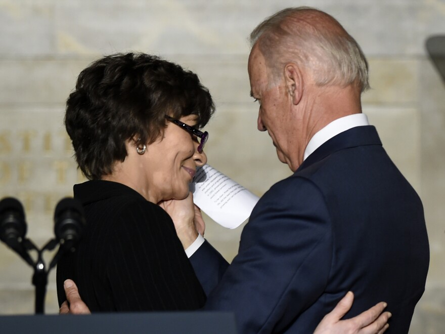 Vice President Joe Biden hugs Ruth Glenn, of the National Coalition Against Domestic Violence, at a commemoration of the 20th Anniversary of the Act. Glenn says that as a victim in 1992, there was no place to turn.