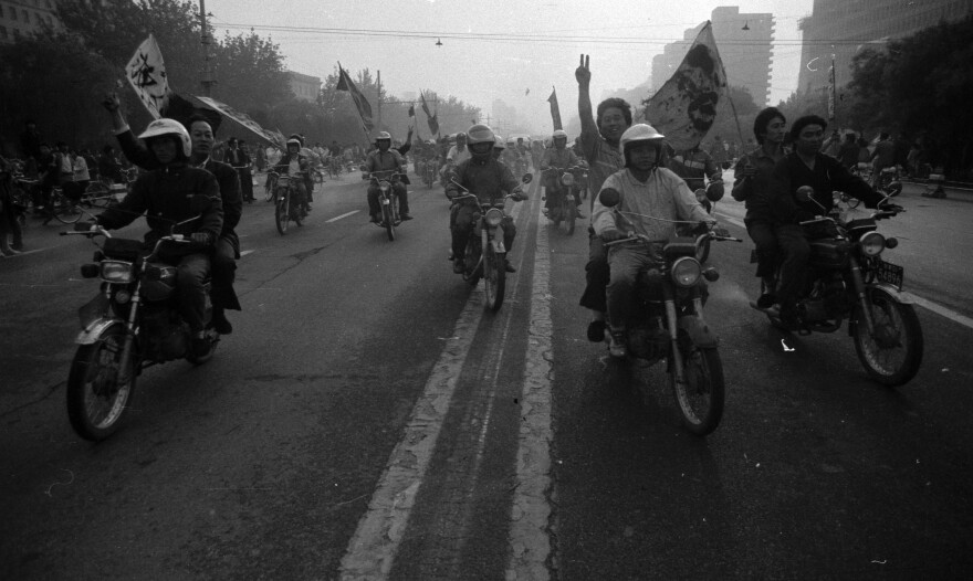 A group of motorcyclists known as the Flying Tigers rides in support of the students on May 30, 1989.