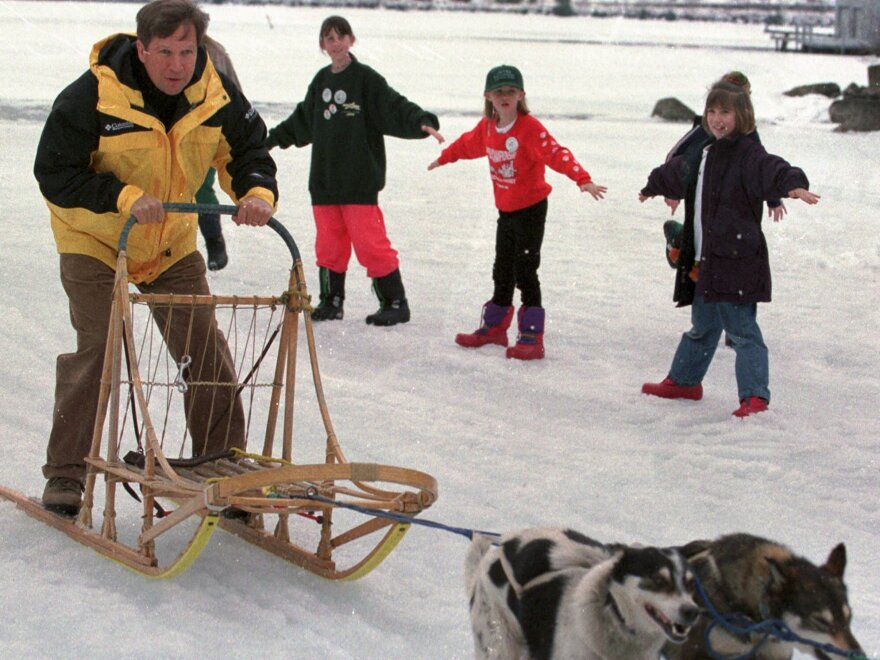 "In 1999, then-Rep. John Kasich rode a dog sled after participating in the World Championship Sled Dog Derby award ceremony in Laconia, N.H. When he ran an ""exploratory"" campaign back then, few people knew who he was."