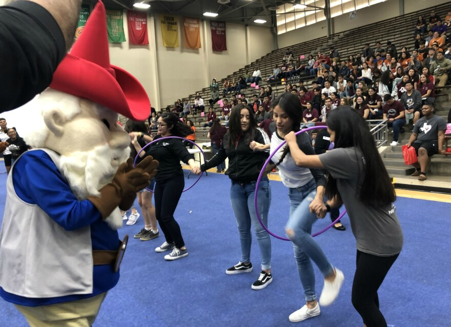 The Gnome Ranger cheers on a group of incoming San Antonio College students at College Signing Day May 3, 2019.