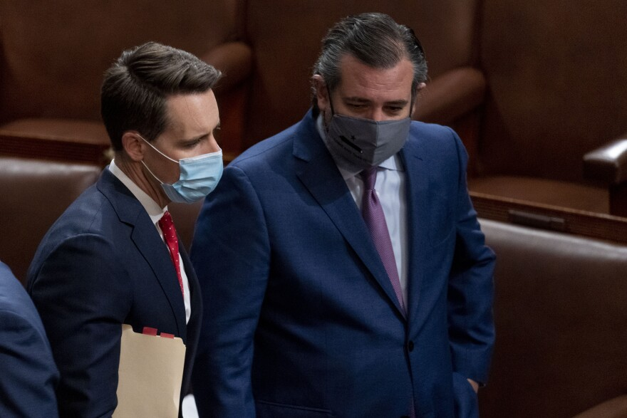 Missouri Sen. Josh Hawley, a Republican, (left) and Sen. Ted Cruz, R-Texas, right, speak after Republicans objected to certifying the Electoral College votes from Arizona, during a joint session of the House and Senate to confirm the electoral votes cast in November's election, at the Capitol, Wednesday, Jan 6, 2021.  (AP Photo/Andrew Harnik)