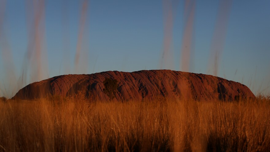 Uluru, seen at sunset from a designated viewing area earlier this year in Australia's Uluru-Kata Tjuta National Park. The sandstone monolith will be closed to climbers permanently Saturday, in a blow to tourists' aspirations and a boon to the aboriginal peoples who consider it sacred.