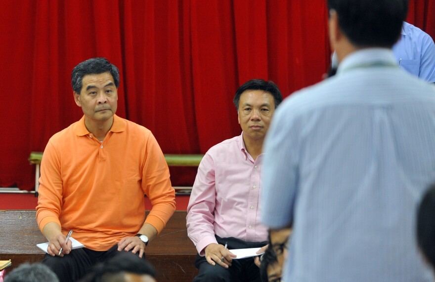 """New Hong Kong Chief Executive Leung Chun-ying visits a Welfare Advancement Association on Monday, a day after taking office. Leung vowed he would """"humbly"""" listen to the public, but some critics branded him a lame duck after the restive city's biggest protest in nearly a decade."""