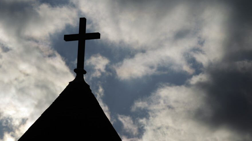 """The cross on the steeple of St. Francis Xavier Catholic Church in Henryville, Ind. A recent Gallup poll says only 44 percent of Americans have """"great confidence"""" in organized religion."""