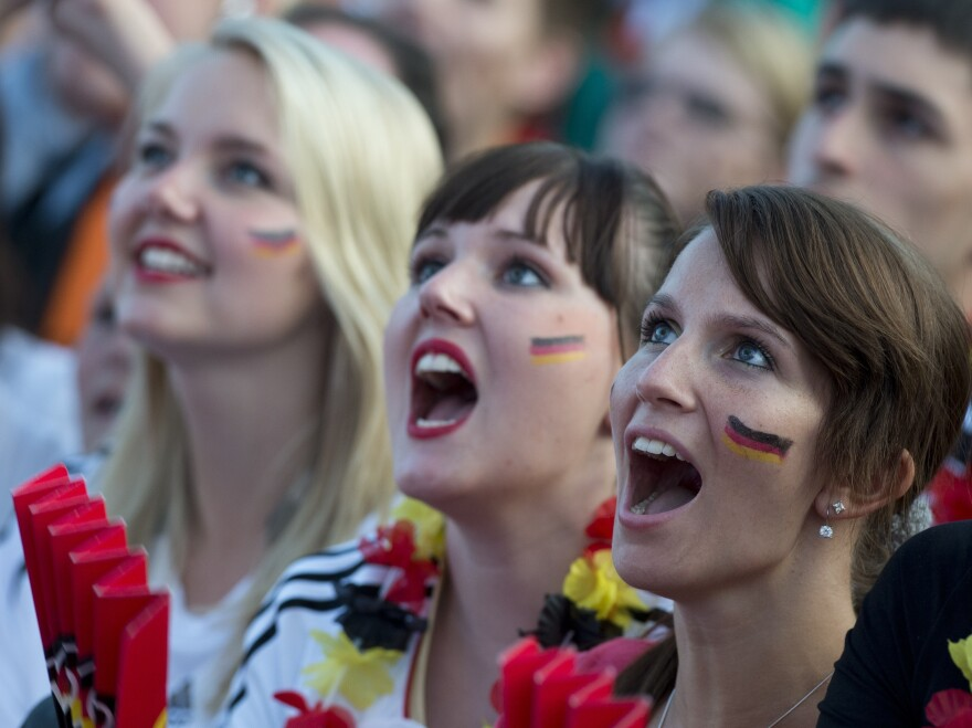 German soccer fans in Berlin cheer on their team June 17 at a public screening of the game against Denmark, which Germany won, 2-1.