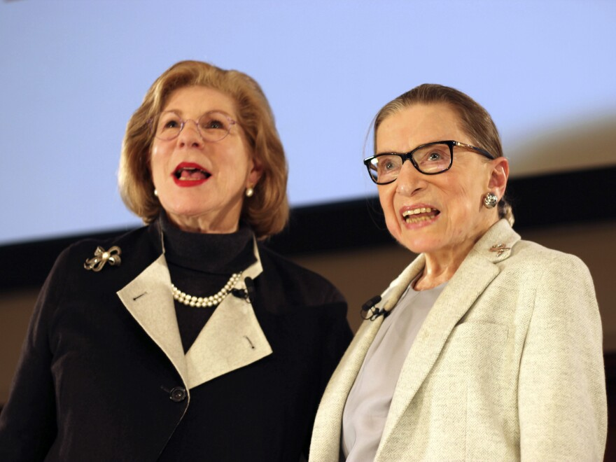 NPR's Nina Totenberg, left, and U.S. Supreme Court Justice Ruth Bader Ginsburg stand onstage at the New York Academy of Medicine after doing a question and answer session as part of the Museum of the City of New York's David Berg Distinguished Speakers Series, Saturday, Dec. 15, 2018, in New York. (AP Photo/Rebecca Gibian)