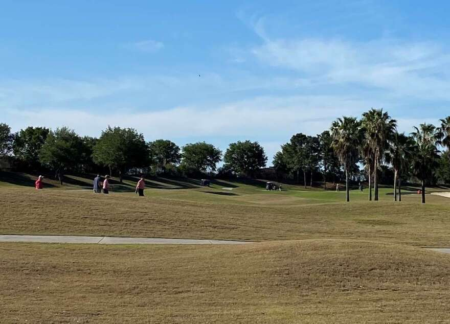 People continue to play golf in The Villages.
